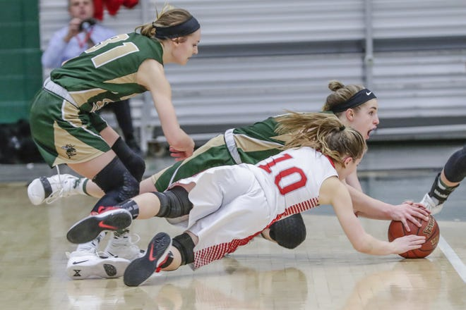 Colby's Alyssa Underwood (31) looks on her teammate Hailey Voelker battles for the ball with Neillsville's Bella Opelt (10) during a WIAA Division 4 girls basketball sectional semifinal game Thursday at D.C. Everest High School in Weston.