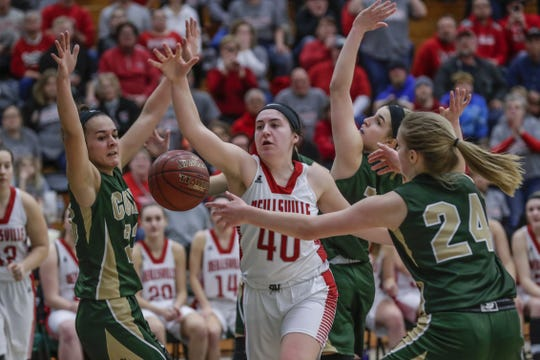 Colby's Vanessa Lopez, left, and teammate Lexi Underwood (24) fight for the ball with Neillsville's Samantha Cappadora (40) during a WIAA Division 4 girls basketball sectional semifinal game Thursday at D.C. Everest High School in Weston.