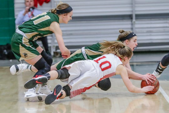 Colby's Alyssa Underwood, left, looks on as teammate Hailey Voelker battles for the ball with Neillsville's Bella Opelt (10) during a WIAA Division 4 girls basketball sectional semifinal game on Feb. 28. The Hornets battled back to win in overtime, a defining moment in their season.