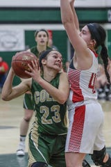 Colby's Vanessa Lopez (23) looks for an opening around Neillsville's Samantha Cappadora (40) during a WIAA Division 4 girls basketball sectional semifinal game Thursday at D.C. Everest High School in Weston.