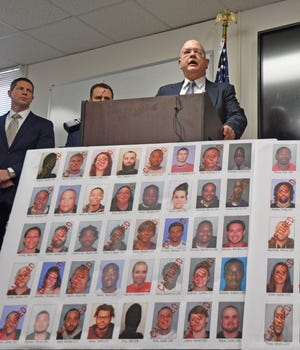 Richland County Prosecutor Gary Bishop speaks Thursday during a press conference regarding a large drug sweep that nabbed 43 suspects.
