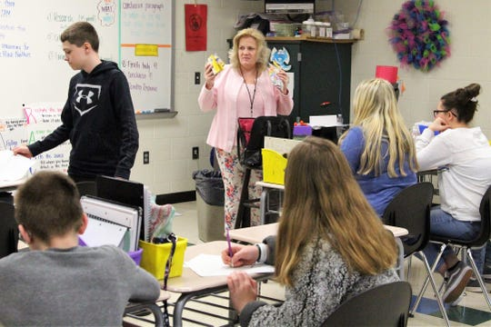 Substitute teacher April Honaker addressees her students for the morning on Wednesday. She often gets her assignments hours before coming in.