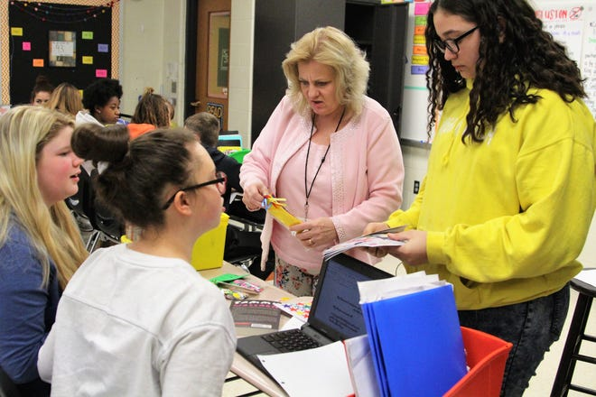 April Honaker, who is pursuing a Masters in Education, fills in for a 7th grade Language Arts class at Grant Middle School on Wednesday. She has been substitute teaching for two weeks.