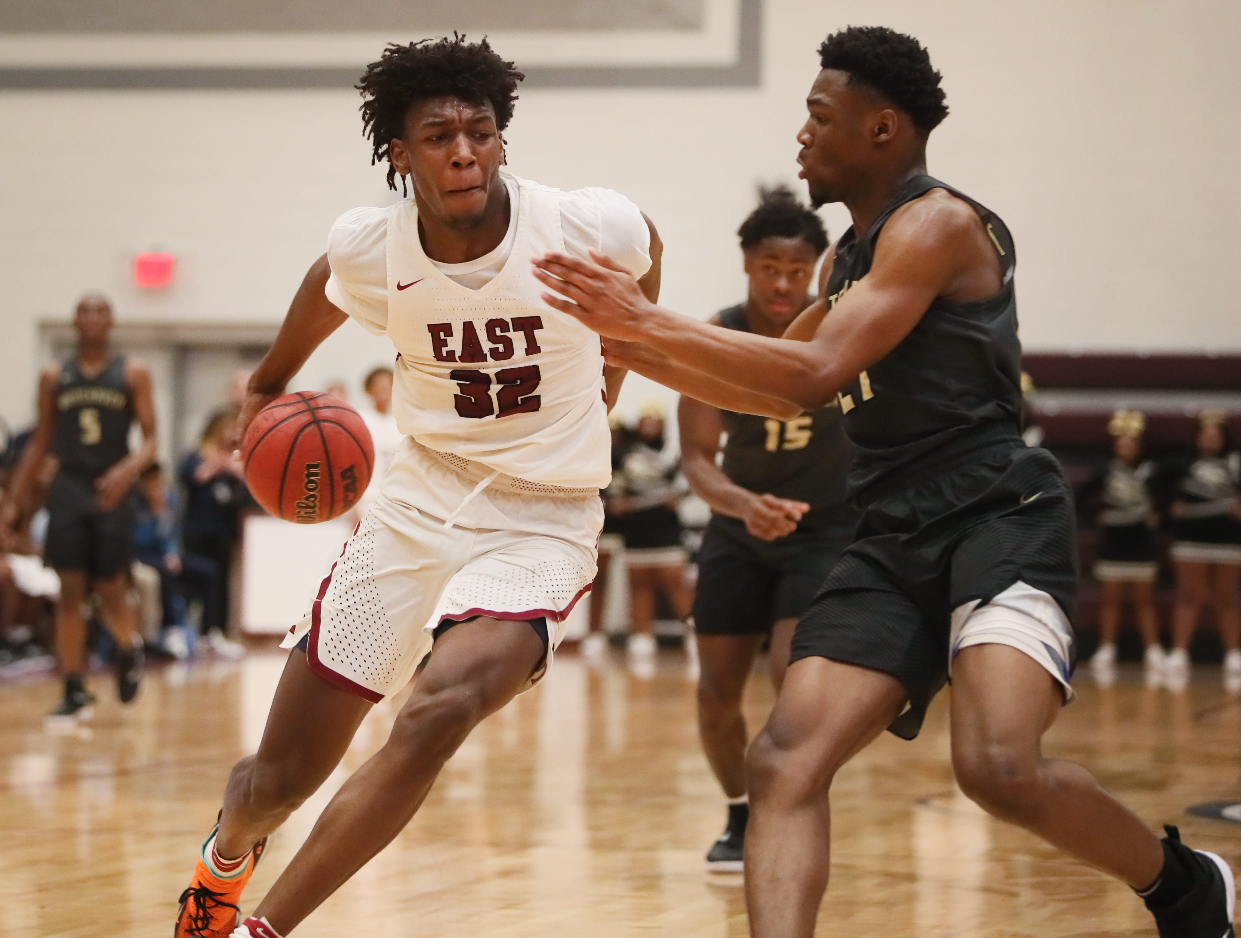 Memphis East's James Wiseman dribbles behind his back, trying to break away from against Whitehaven's Devine Owens during their Region 8AAA Championship game at Collierville High School on Thursday, Feb. 28, 2019.