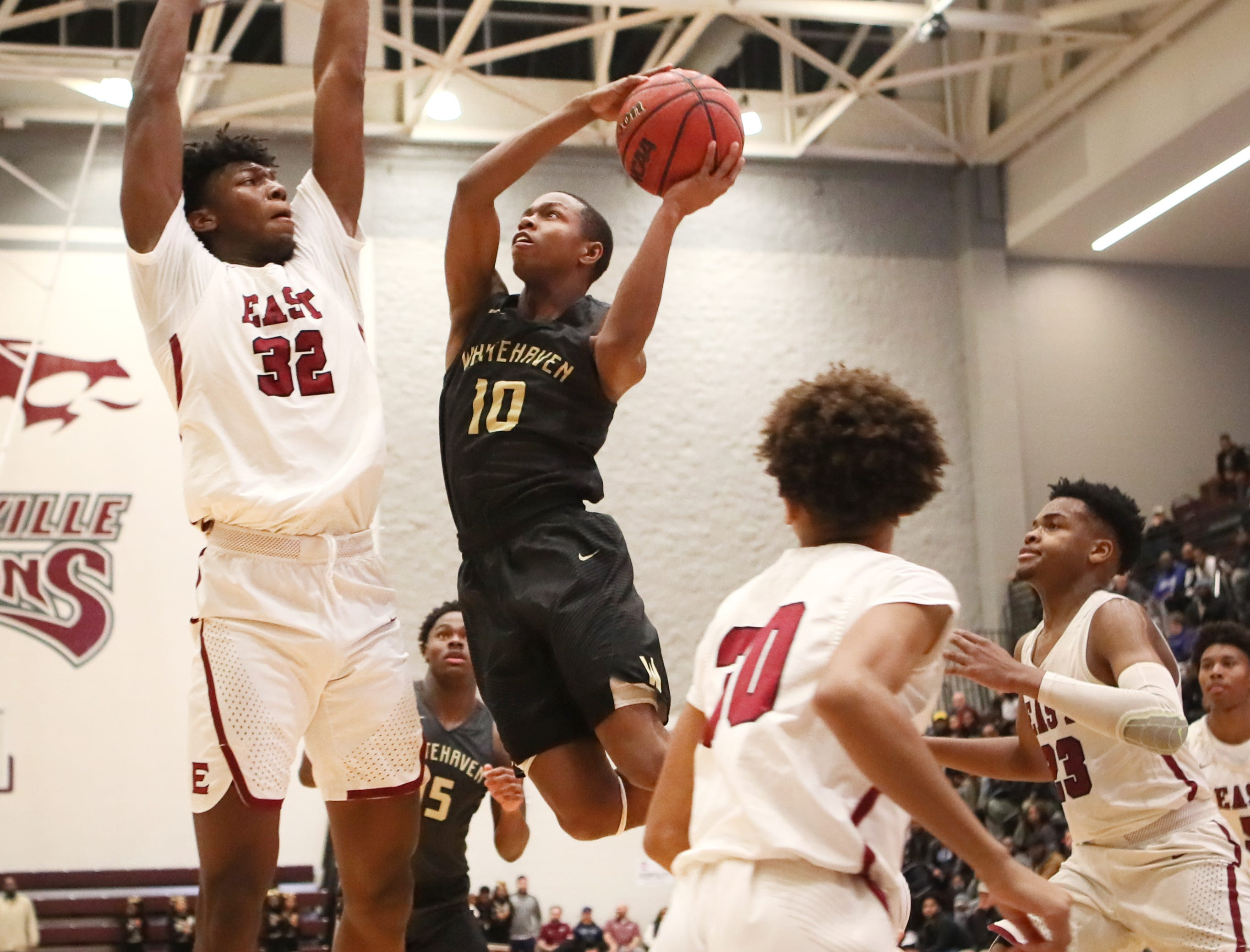 Whitehaven's Antnarn Smith tries to put a shot up against the defense of Memphis East's James Wiseman during their Region 8AAA Championship game at Collierville High School on Thursday, Feb. 28, 2019.