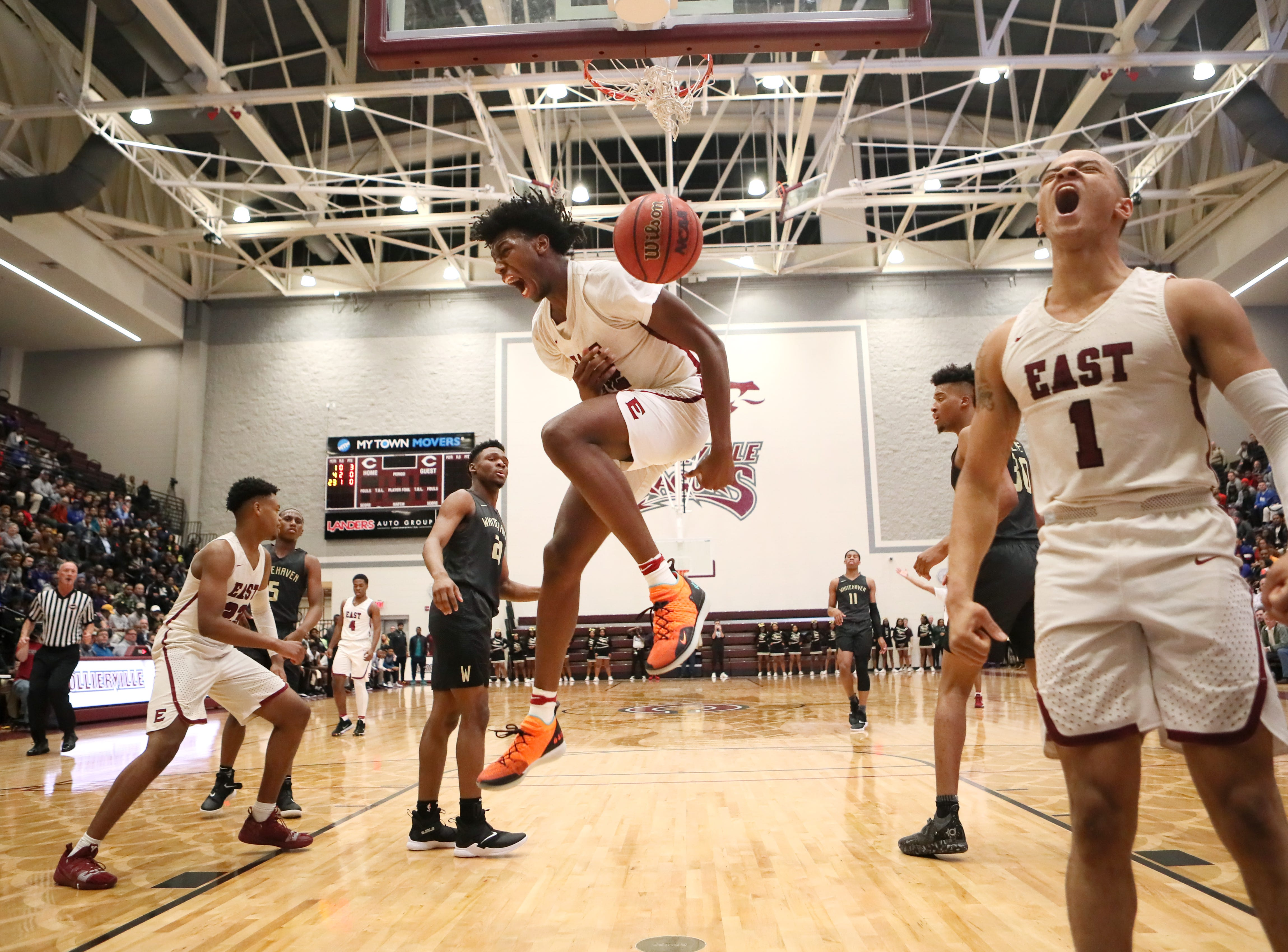 Memphis East's James Wiseman celebrates his dunk while teammate Antonio Thomas joins in to celebrate his assist on the play against Whitehaven during their Region 8AAA Championship game at Collierville High School on Thursday, Feb. 28, 2019.