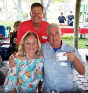 The winner of the nautical quiz, Carol and Charles Schwalje with Todd Whitney.