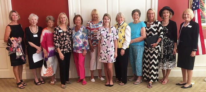 Bargain Basket manager, Samantha Kopren, center, flanked by members of Marco Island Daughters of the American Revolution wearing fashions from the thrift shop.