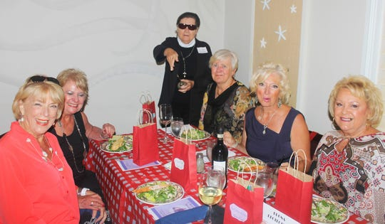 Father Alfredo (Linda Sobelewski) blesses the food and patrons at LaSperanza Ristorante; with Litha Berger, Pat Hagedorn, Hildie Keyes, Rose Kraemer and RuthLee DeVaughn.