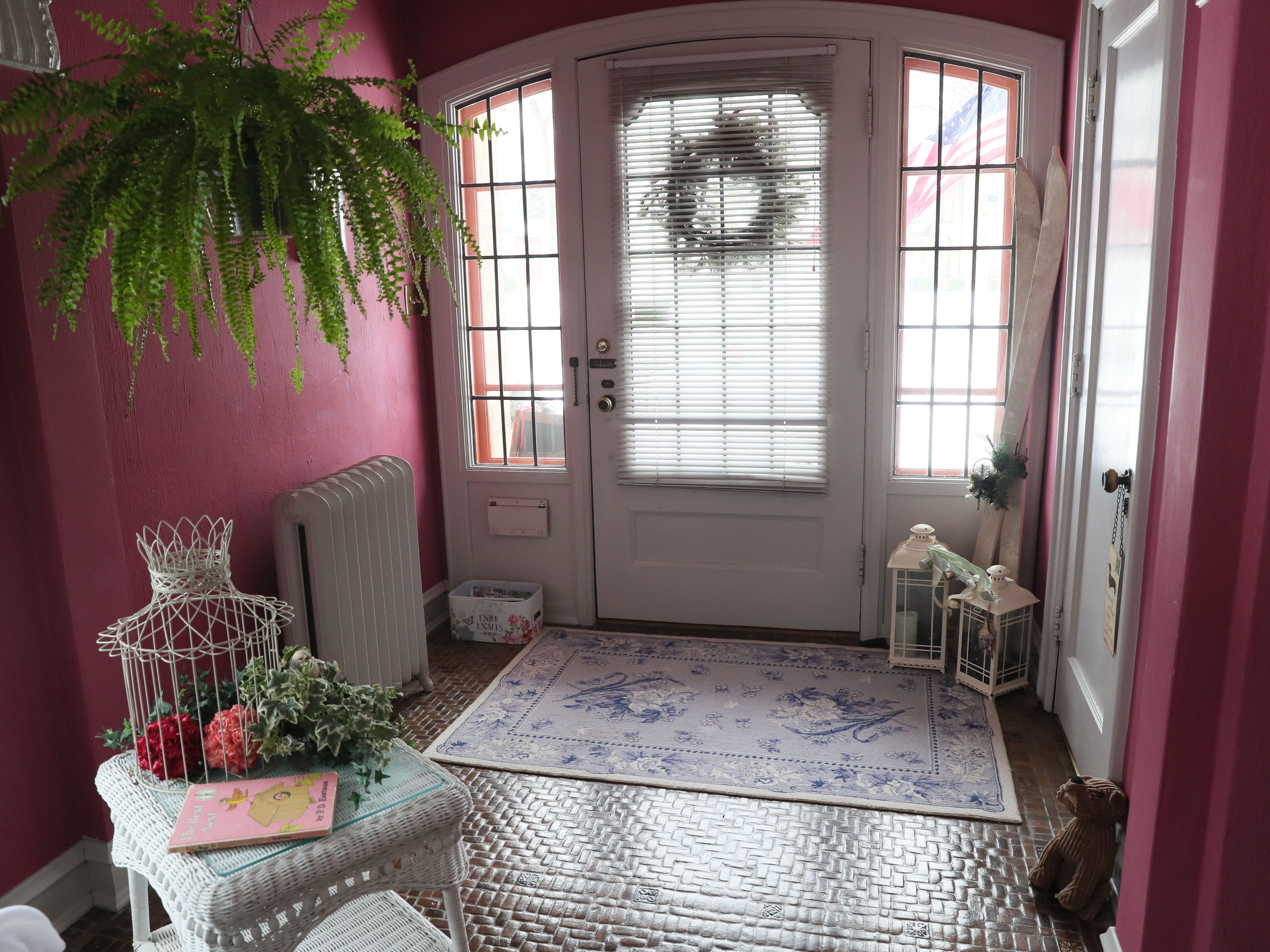 The front door opens to an entryway leading to the sunroom.