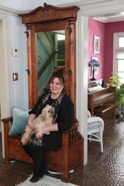 Zoe Krause sits with one of her three Shih Tzus, Cindy Lou Who.