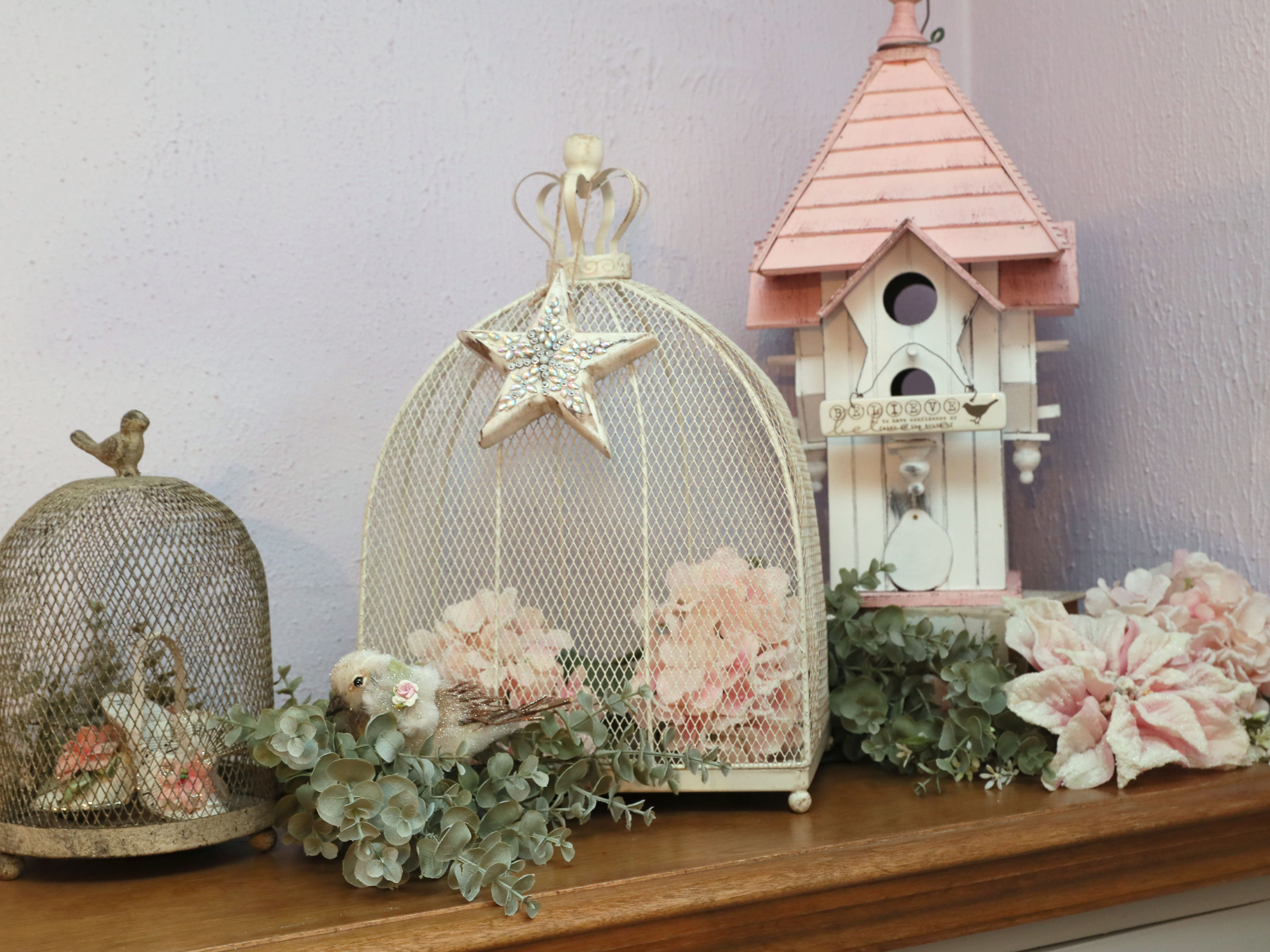 Bird cage and birdhouses are on display in the dining room.