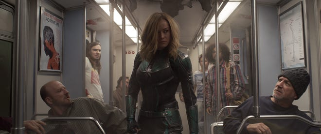 "Captain Marvel (Brie Larson) has a big fight on her hands, and a riddle of her own to solve, in ""Captain Marvel."""