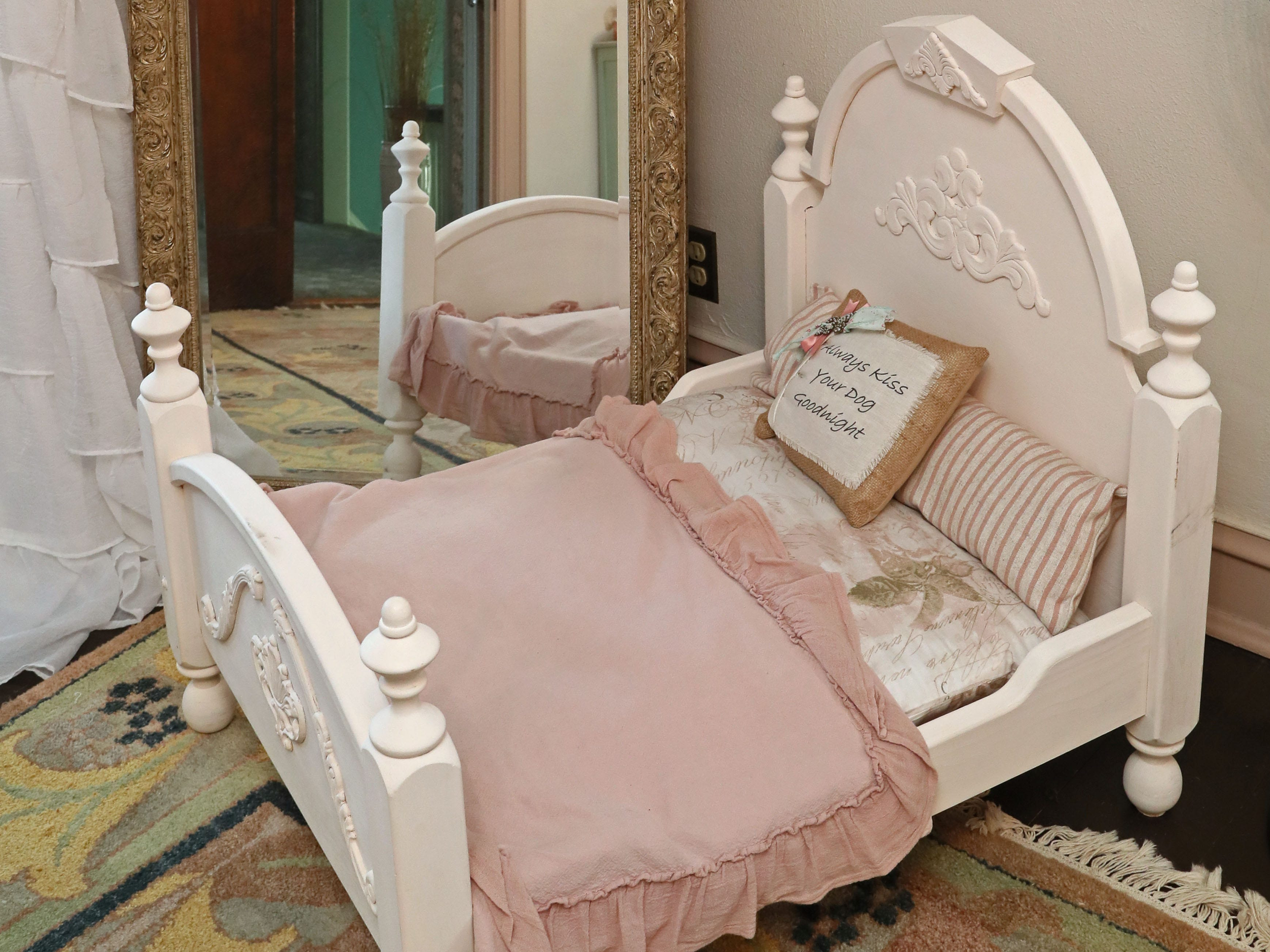 This dog's bed in the master bedroom was made by Zoe Krause's father.