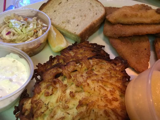 The bluegill plate at Romey's Place in Franklin, with caraway rye, slaw in vinegar, dill tartar sauce and optional potato pancakes.