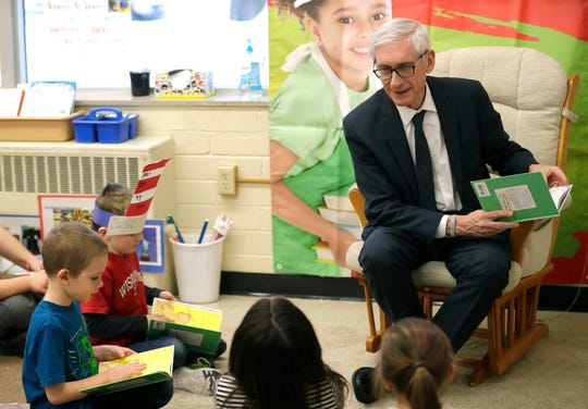 Governor Tony Evers reads a Dr. Seuss book to third-grade students at Lincoln Elementary School in Appleton.