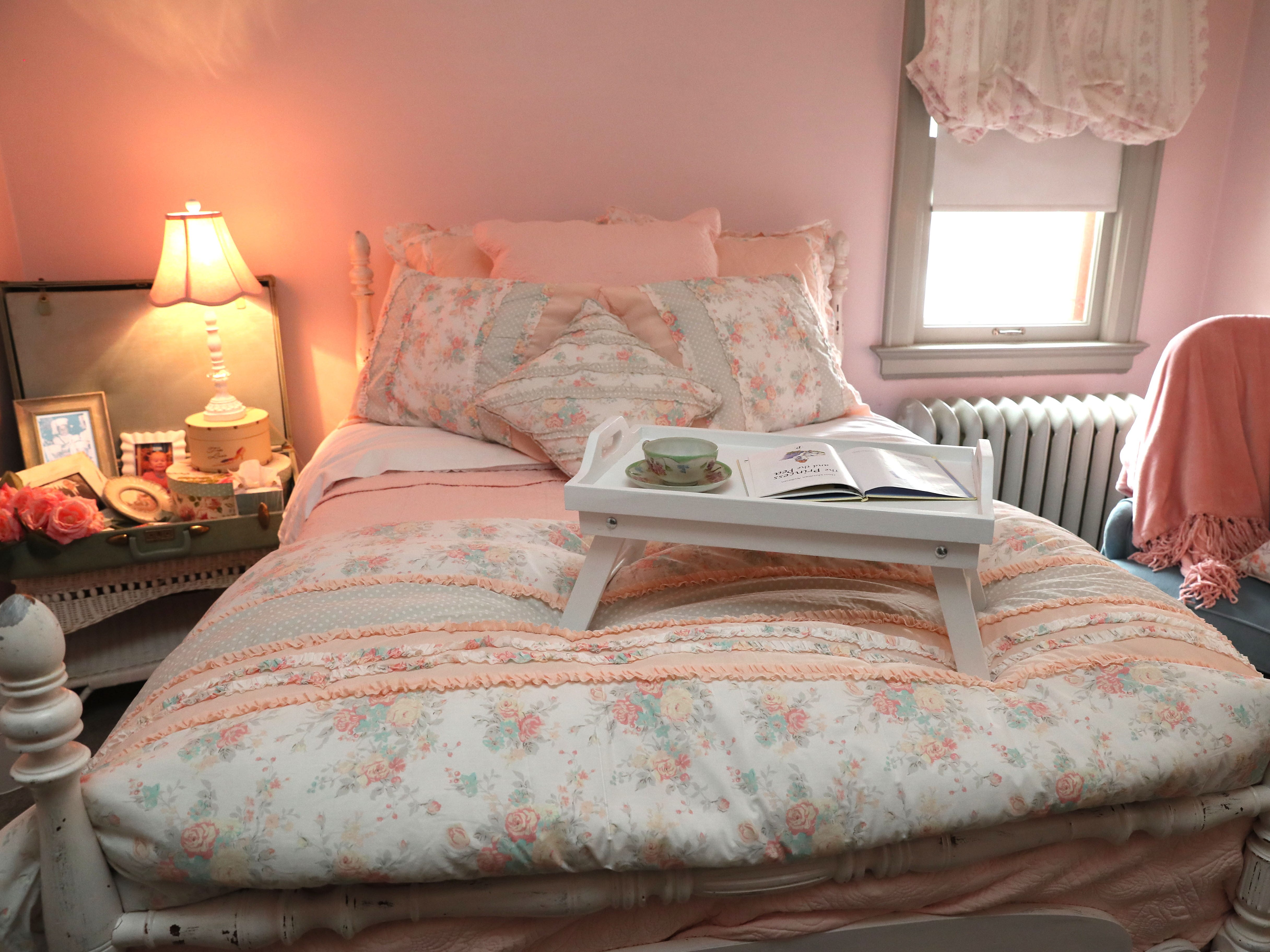 Zoe Krause calls this guest bedroom her mom's room partly because it's done in the peachy-pink colors her mother loves.