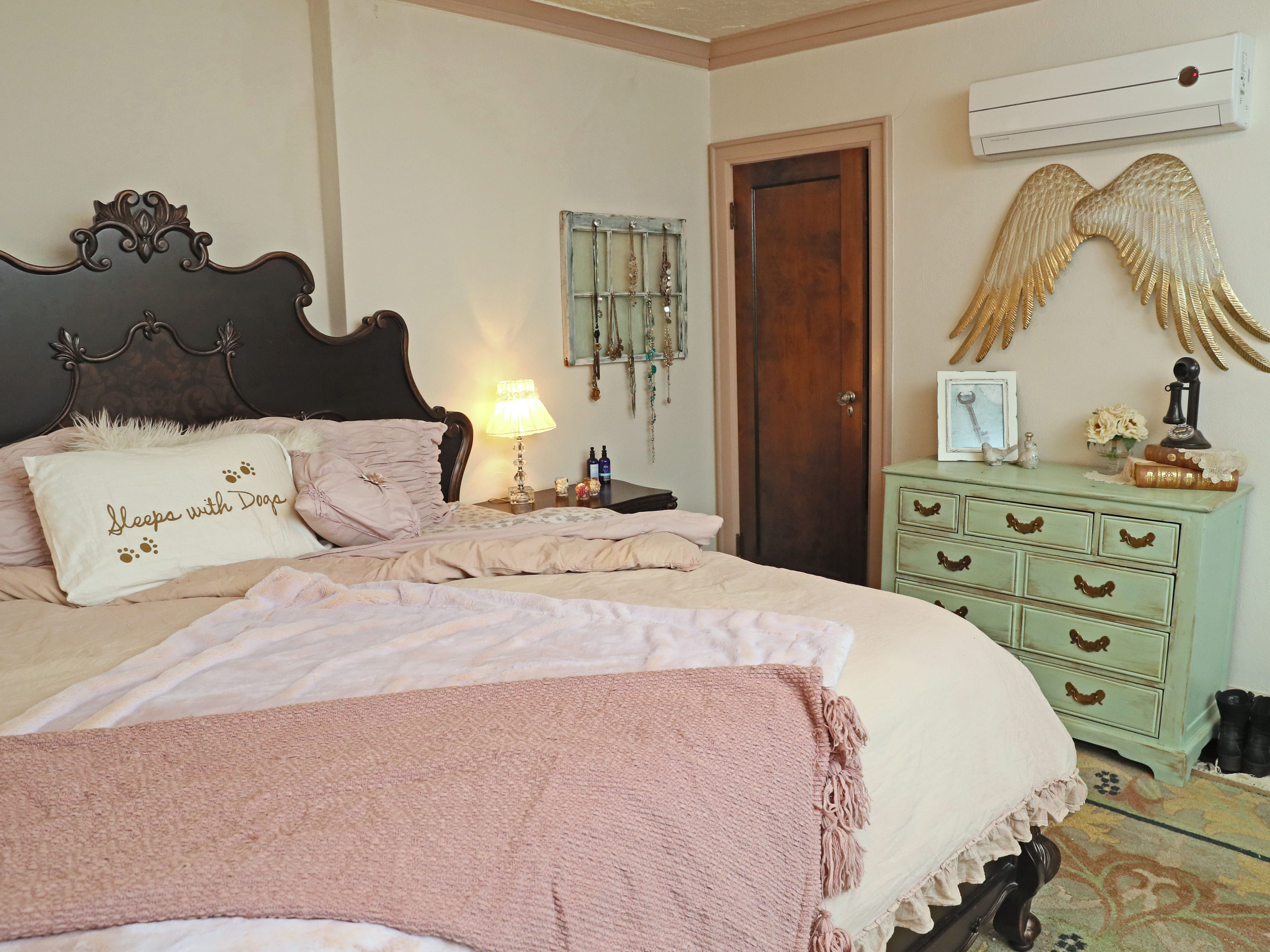 The master bedroom includes the owner's mom's childhood dresser that her mom redid for her in a light green distressed color.