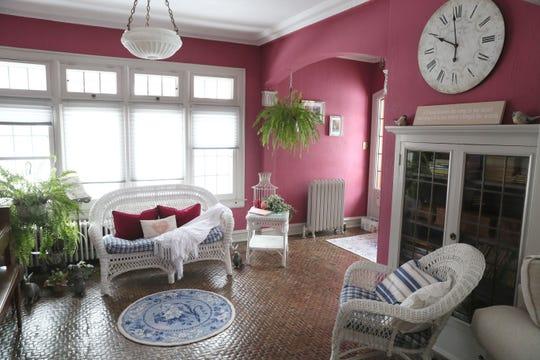 White wicker furniture brightens up the sunroom.