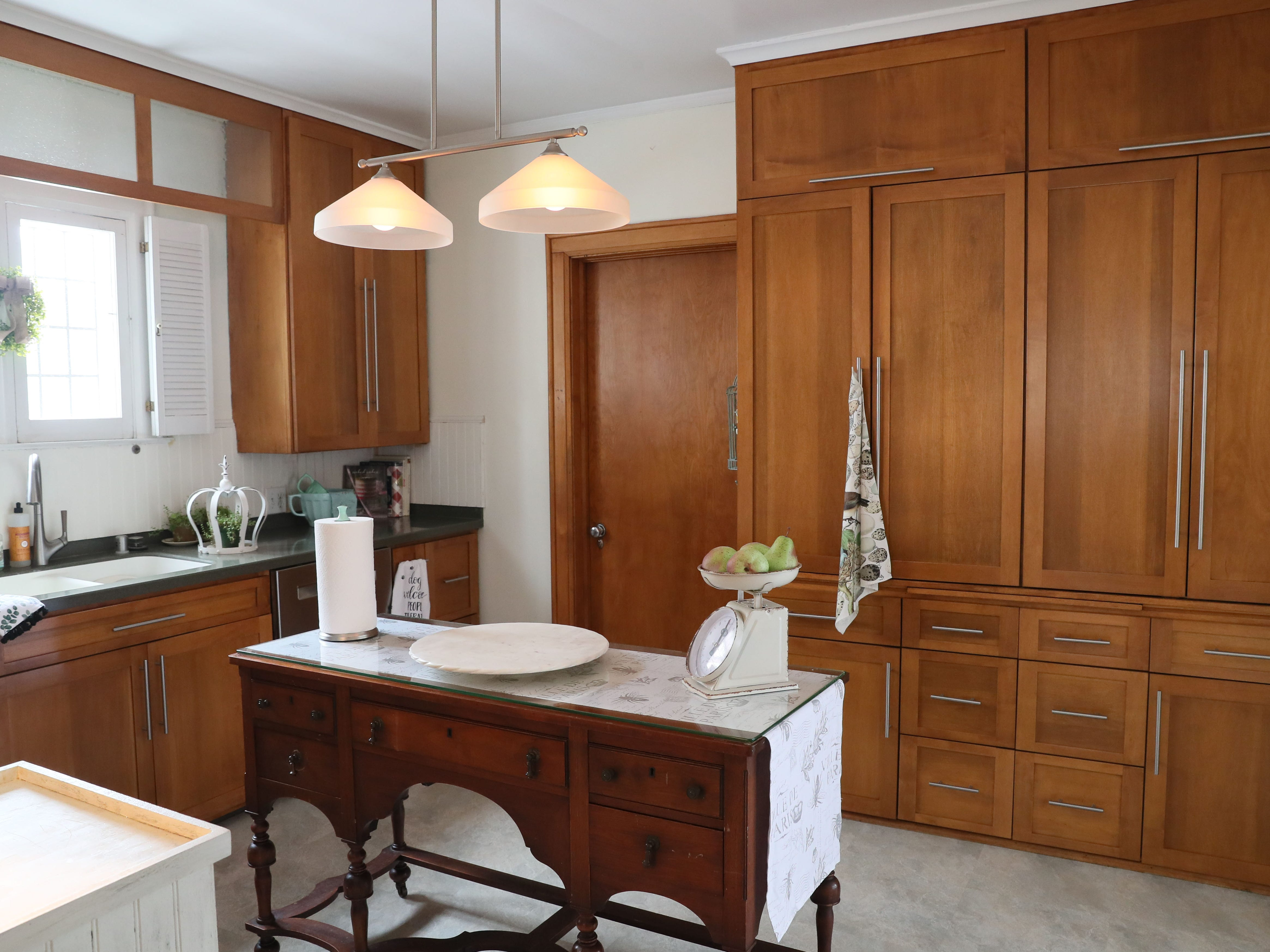 The cabinets in the kitchen are original, but the previous homeowner had the doors refaced.