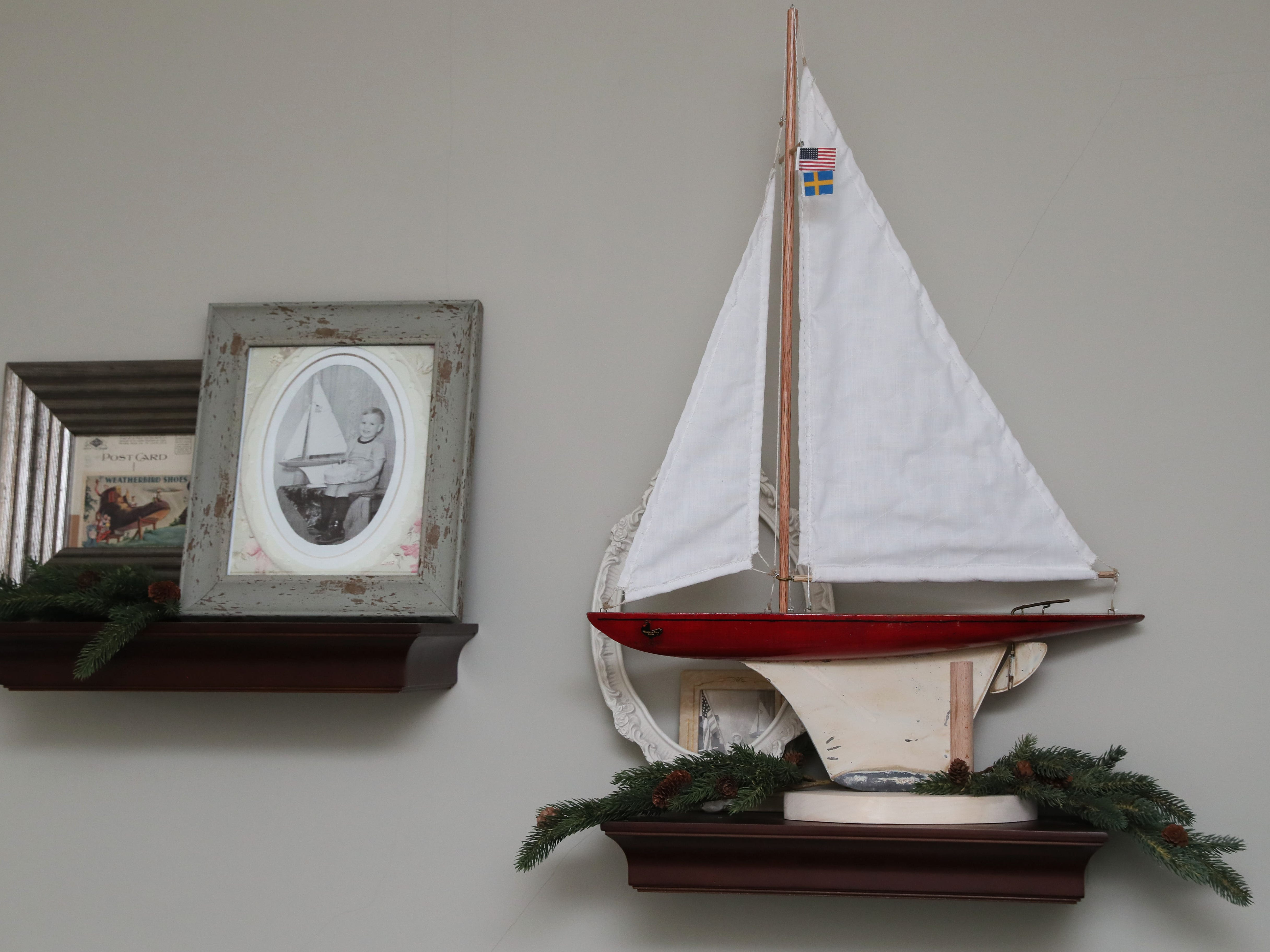 One of Zoe Krause's favorite pieces is this model sailboat made by her father  when he was 3 years old, next to a photo of him at that age holding it. These are on display in a guest bedroom.