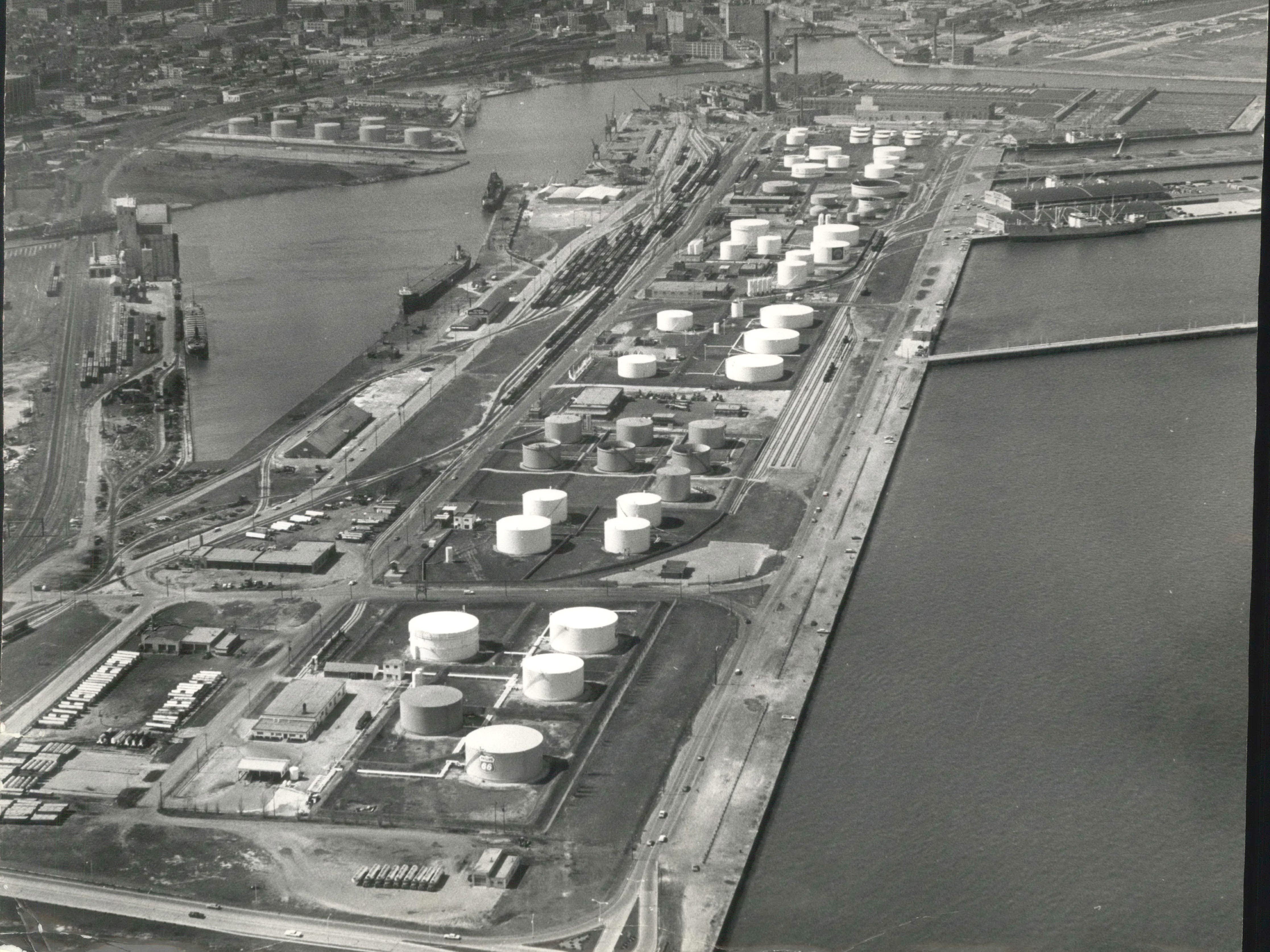 Oil companies with storage tanks on Jones Island have been ordered to make necessary repairs to stop the leakage of gasoline into sewer lines, or be closed down by city officials.  The map relates the island storage facilities to downtown Milwaukee.  The terminals have a capacity of 70 to 80 million gallons of petroleum products used to supply fuel to distributors in Milwaukee and the southwest quarter of Wisconsin.  Samples taken recently from an island sewer contained almost pure gasoline.  Air Views-Jones Island