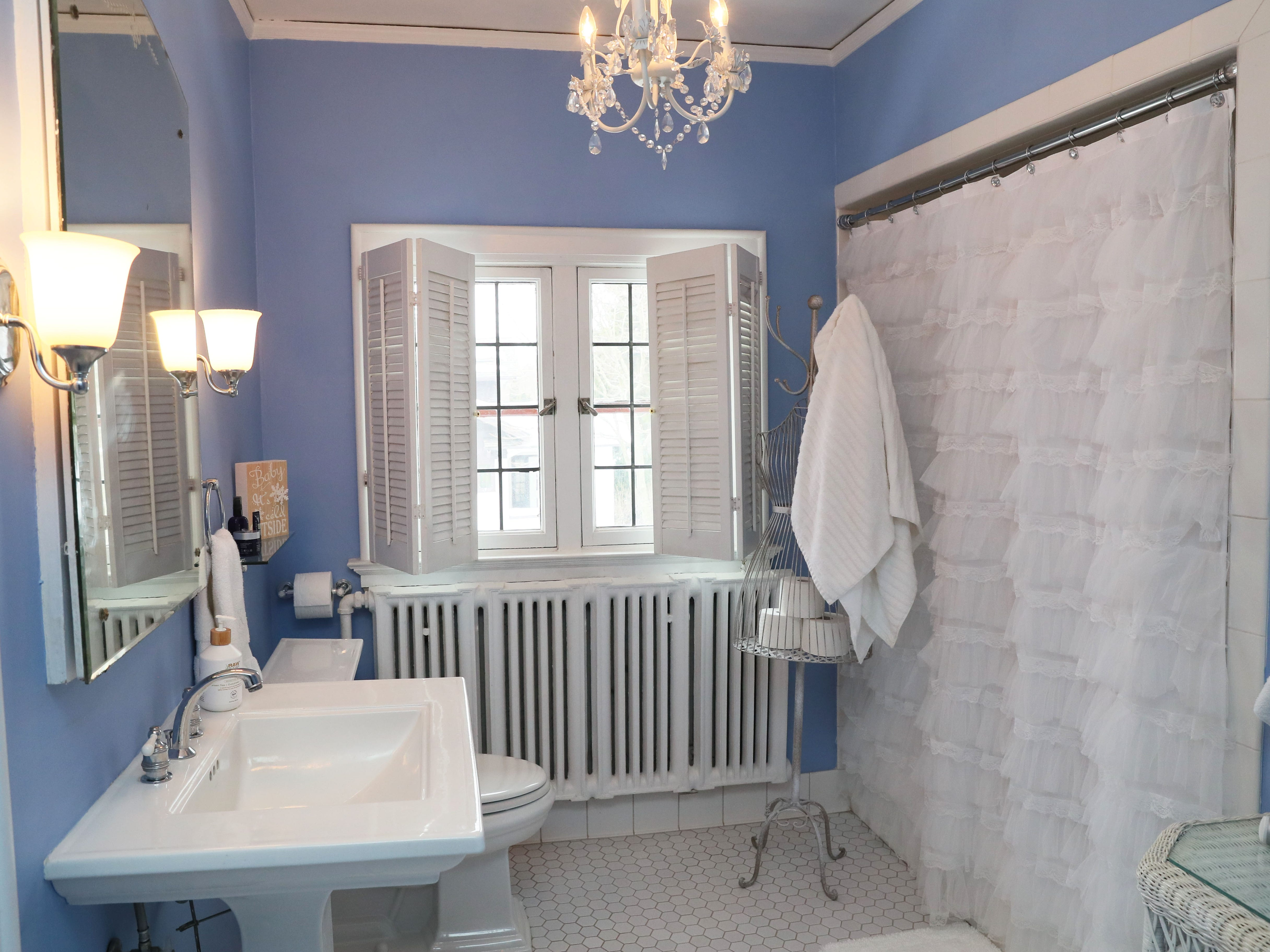 The master bathroom is painted periwinkle.