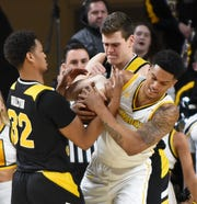 UW-Milwaukee's Wil Sessoms (right) wrestles for the ball with Northern Kentucky's Dantez Walton on Thursday night.