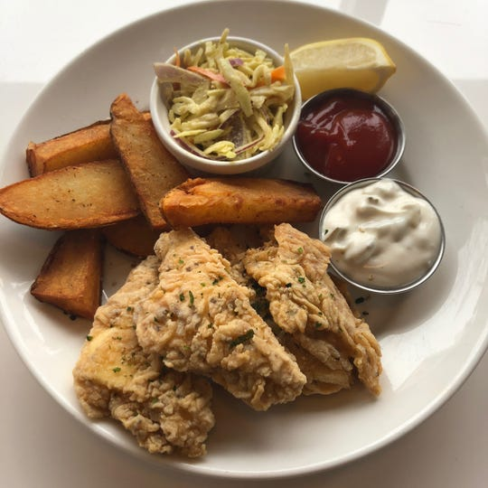 The crisp fishless fry at the vegan restaurant Celesta, 1978 N. Farwell Ave., comes complete with tartar, coleslaw and fried potato wedges.