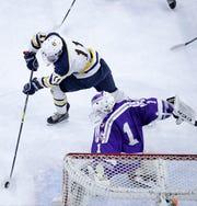 University School's Tyler Herzberg puts a shot on goal against Onalaska Co-op's Jack Weber on Thursday.
