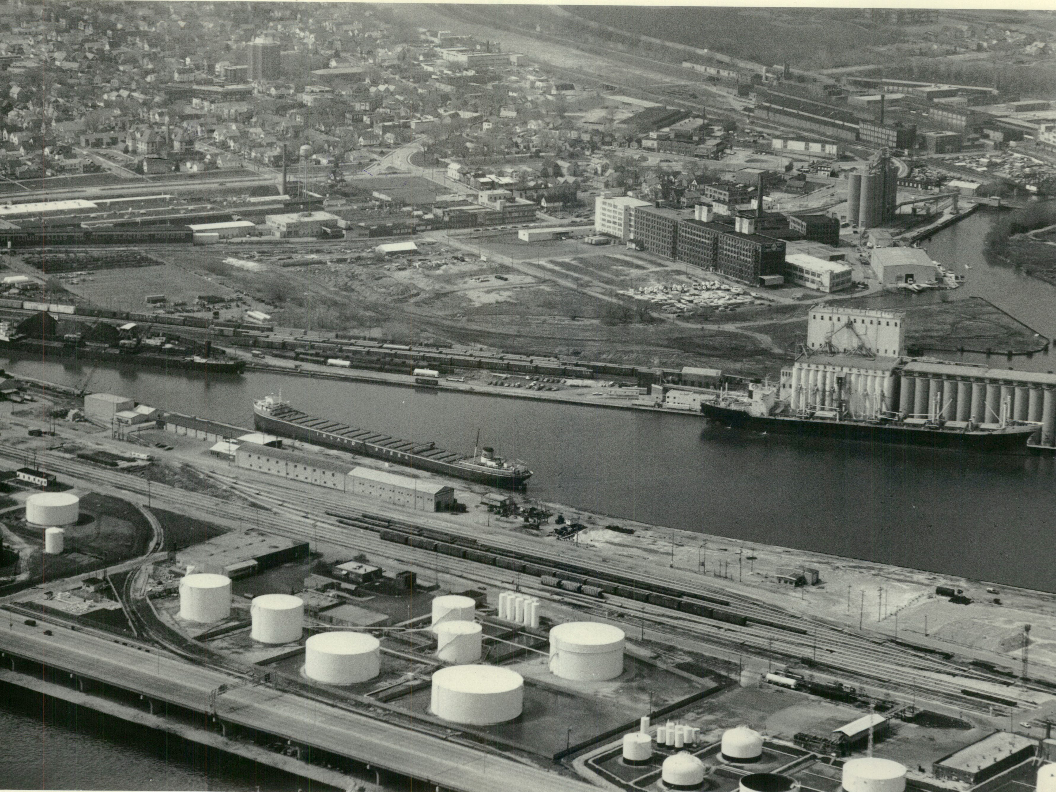 Fuel storage tanks line the south portion of Jones Island (foreground) in this aerial view looking west across the Kinnickinnic River.  Jones Island-Aerial