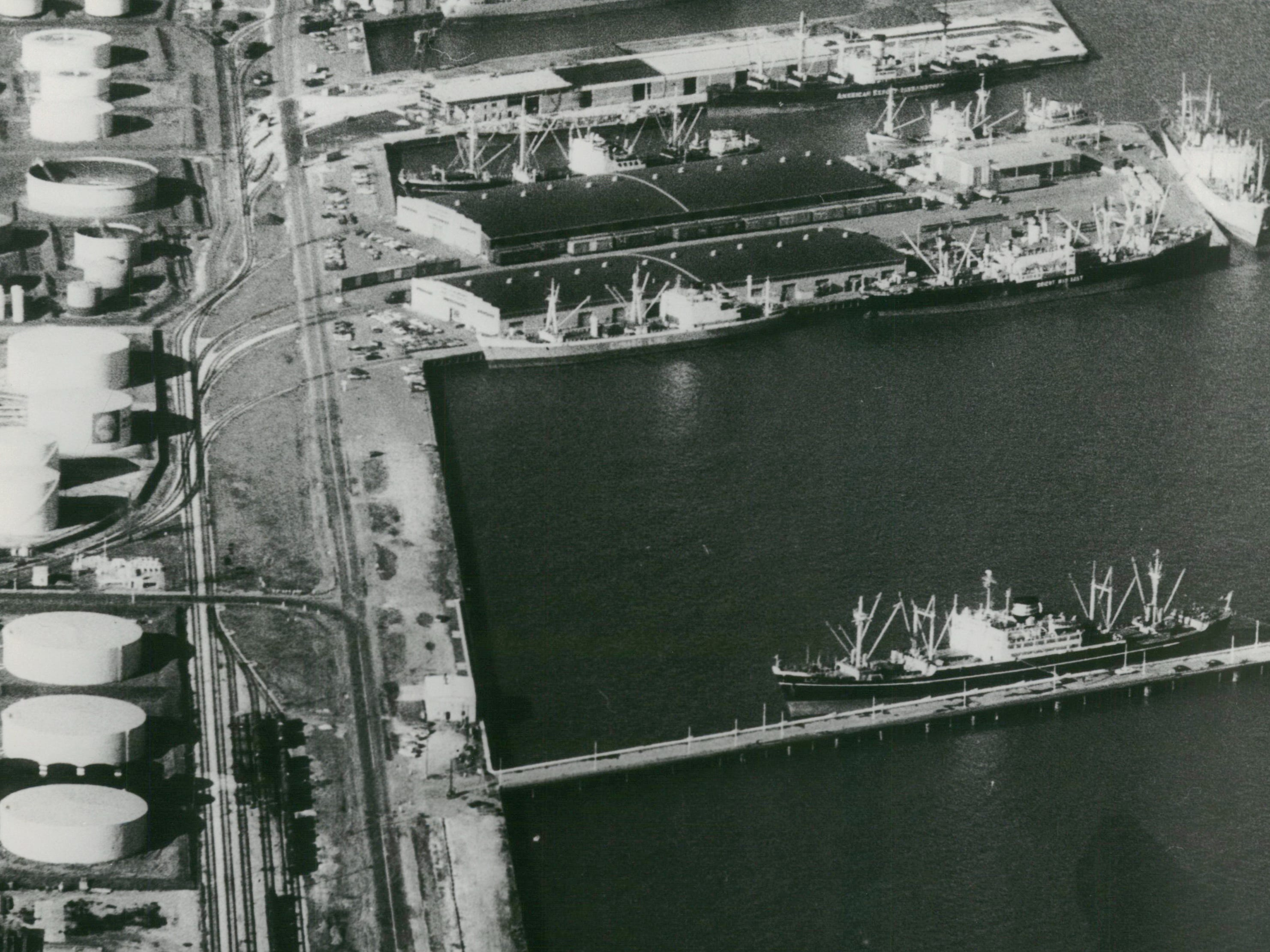 Milwaukee's harbor was a busy place as shipping activity increased to beat the Dec. 3, 1996, closing of the St. Lawrence Seaway.  Longshoremen were busy loading and unloading 11 ships, 10 of which can be seen in this aerial photo of the berthing at Jones Island, Milwaukee.