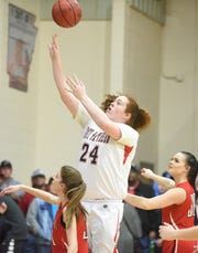 Norfork's Hannah Bryant puts up a shot against Rural Special in Thursday night's quarterfinal game.