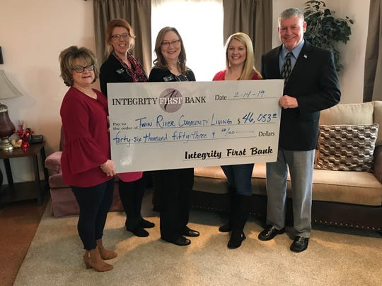 Janet Evans, VP Trust Officer with Integrity First Bank, recently presented a check in the amount of $46,053 to Twin River Community Living Facility (TRCLF). The check was presented on behalf of the Adeline Dvorak Trust, administered by Integrity First Bank Trust, Wealth & Investment Management Services. Pictured are: (from left) Gayle Moore, SVP, Lending Officer at Integrity First; Jaren Beavers, VP, Business Development & Marketing, at Integrity First Bank; Evans; Olivia McDaniel, TRCLF Director; and Gary Smith, President, TRCLF Board of Directors. Twin River Community Living Facility is a non-profit organization dedicated to providing a caring home to developmentally delayed clients. Founded in 1979, TRCLF consists of a group home, as well as independent living apartments where they work with each client to achieve their highest potential. For more information about Twin River Community Living Facility, please visit www.trclf.com.  For more information about Integrity First Bank Trust, Wealth & Investment Management Services, please visit www.goifb.com or call (870) 425-1801.