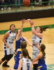 Cotter's Hailey Cunningham (11) puts up a shot as teammates Sam Sanchez (20) and Christianne Crunkleton (5) look to rebound during a recent district tournament game.