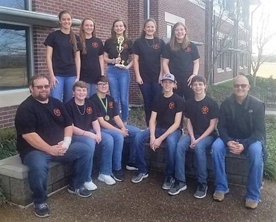 The Calico Rock Junior High Quiz Bowl team took third place in the Red Division as the Class 1A AGQBA State Tournament in Morrilton. The team went 4-2 in its six matches and Zane Fountain earned a spot on the All-Tournament Team. Members of the team are: (first row, from left)  coach Richard Ivy, Riley Whiteaker, Zane Fountain, Blake Moody, Audric Browning, assistant coach/judge John Duffie; (second row) Emma Colbert, Shayna Staggs, Allison Humphries, Mattie Thornton and Lily Grigg. Fountain will compete today in an All Star game.