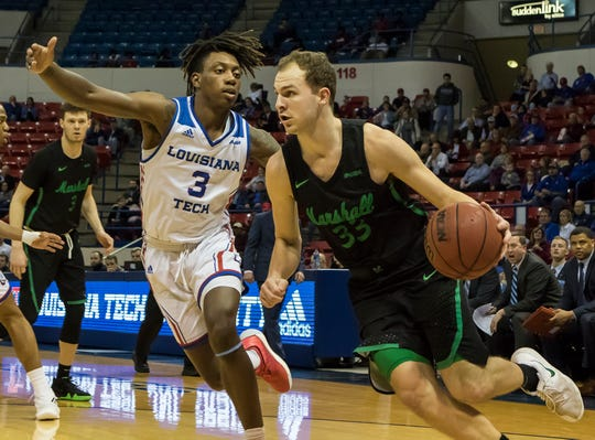 Marshall's Jon Elmore (33) drives a lane towards the hoop while Louisiana Tech's Amorie Archibald (3) attempts to guard during the game at the Thomas Assembly Center in Ruston, La. on Feb. 28.