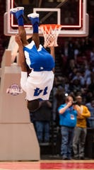 Central-Coosa's Jovon Richardson does a backflip after defeating Sacred Heart in the AHSAA 2A championship game at Legacy Arena in Birmingham, Ala., on Friday March 1, 2019.