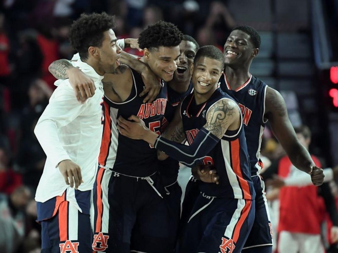 Auburn teammates celebrate with Chuma Okeke (5) after he made the game-winning shot against Georgia on Feb. 27, 2019, in Athens, Ga.