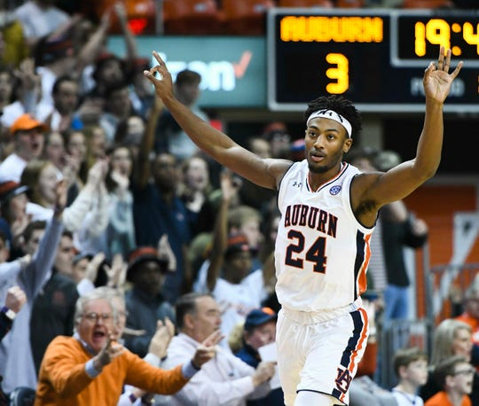 Auburn forward Anfernee McLemore (24) celebrates a three-point shot against Arkansas during the first half of an NCAA college basketball game Wednesday, Feb. 20, 2019, in Auburn, Ala.