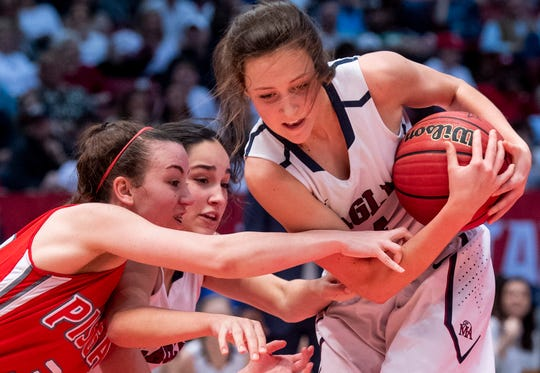 Montgomery Academy's Leighton Robertson grabs a loose ball against Pisgah in the AHSAA 3A championship game at Legacy Arena in Birmingham, Ala., on Friday March 1, 2019.