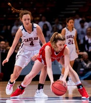 Pisgah's Annie Hughes grabs a loose ball against Montgomery Academy's Leighton Robertson in the AHSAA 3A championship game at Legacy Arena in Birmingham, Ala., on Friday March 1, 2019.