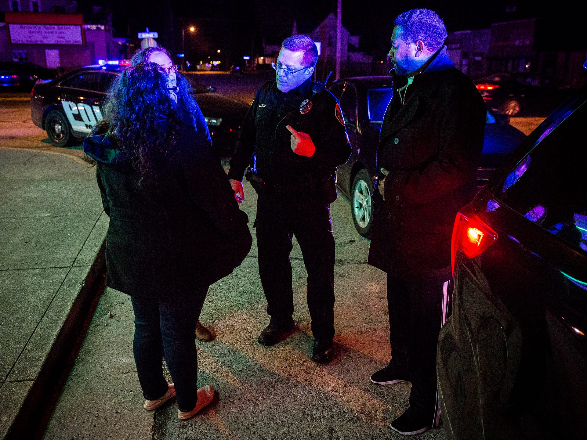 Training director officer Jeff Lacy speaks with graduates of the Muncie Citizen Police Academy during a traffic stop. The academy is part of the city police department's outreach effort and was designed to show citizens what it's like to work as a police officer.