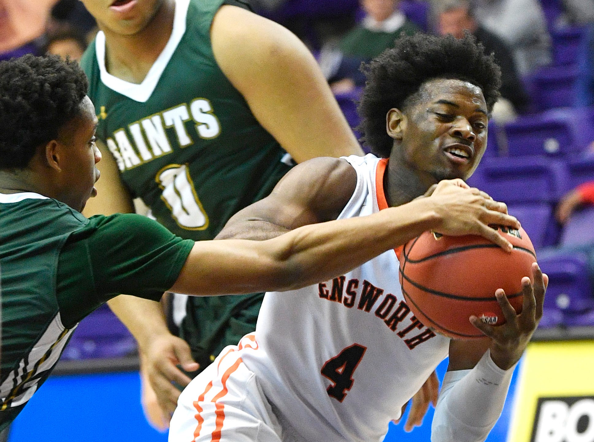 Keshawn Lawrence is tripped up as Ensworth plays Briarcrest Christian in the Division II- AA semifinals at Allen Arena  Thursday, Feb. 28, 2019, in Nashville, Tenn.