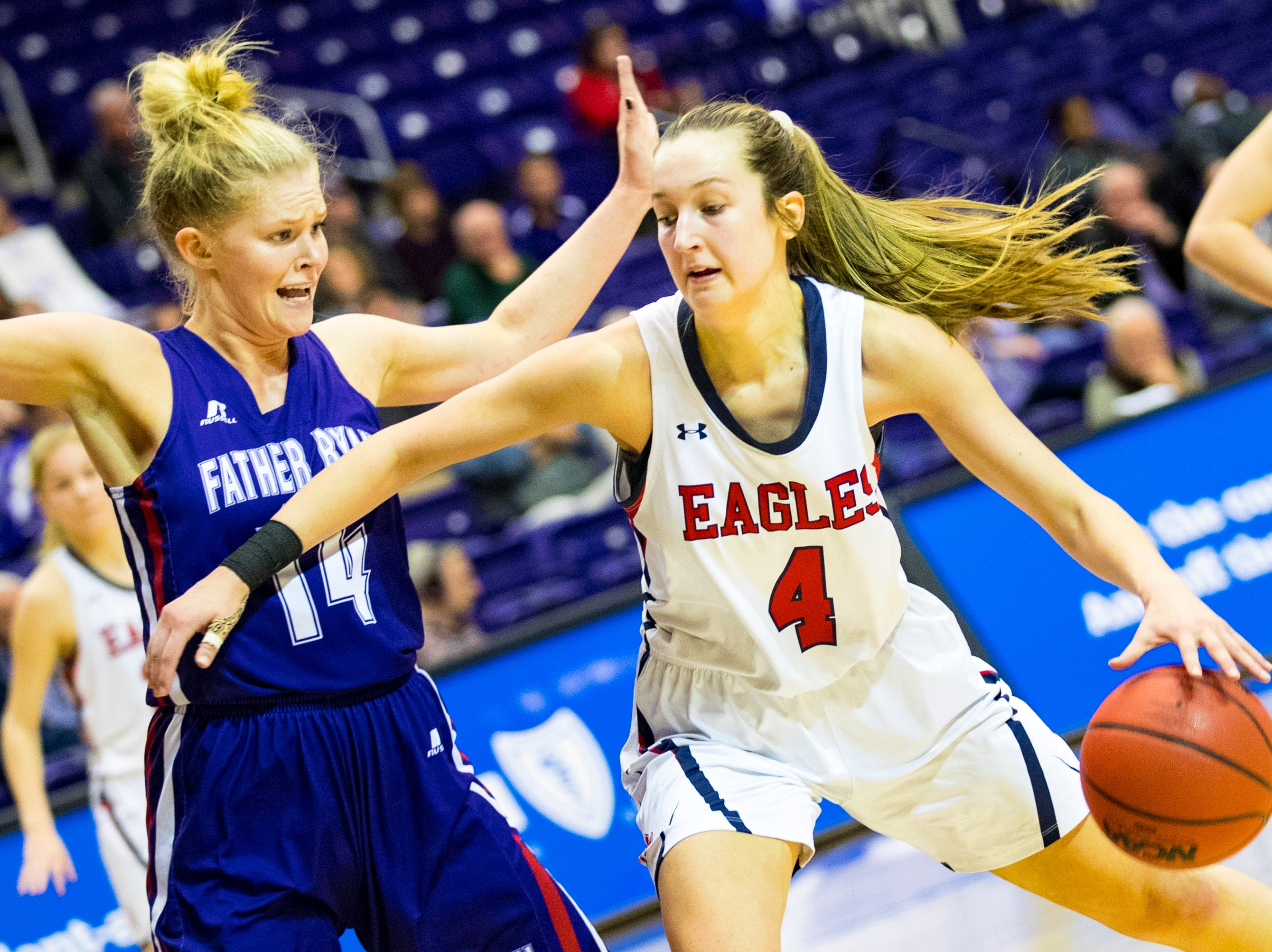 Father Ryan's Bree Thibeault (14) defends against Brentwood Academy's Maggie Brown (4) during Brentwood Academy's game against Father Ryan in the semifinal round of the TSSAA Division II Class AA State Championships at Lipscomb University's Allen Arena in Nashville on Thursday, Feb. 28, 2019.