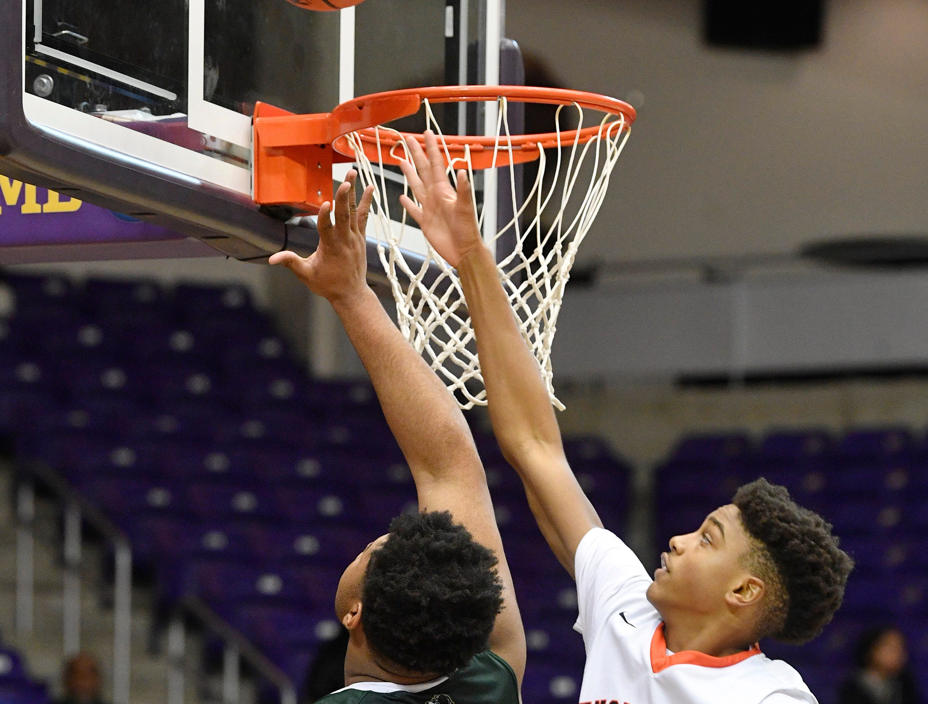 As Omari Thomas goes up Chaz Lanier tries to block as Ensworth plays Briarcrest Christian in the Division II- AA semifinals at Allen Arena  Thursday, Feb. 28, 2019, in Nashville, Tenn.