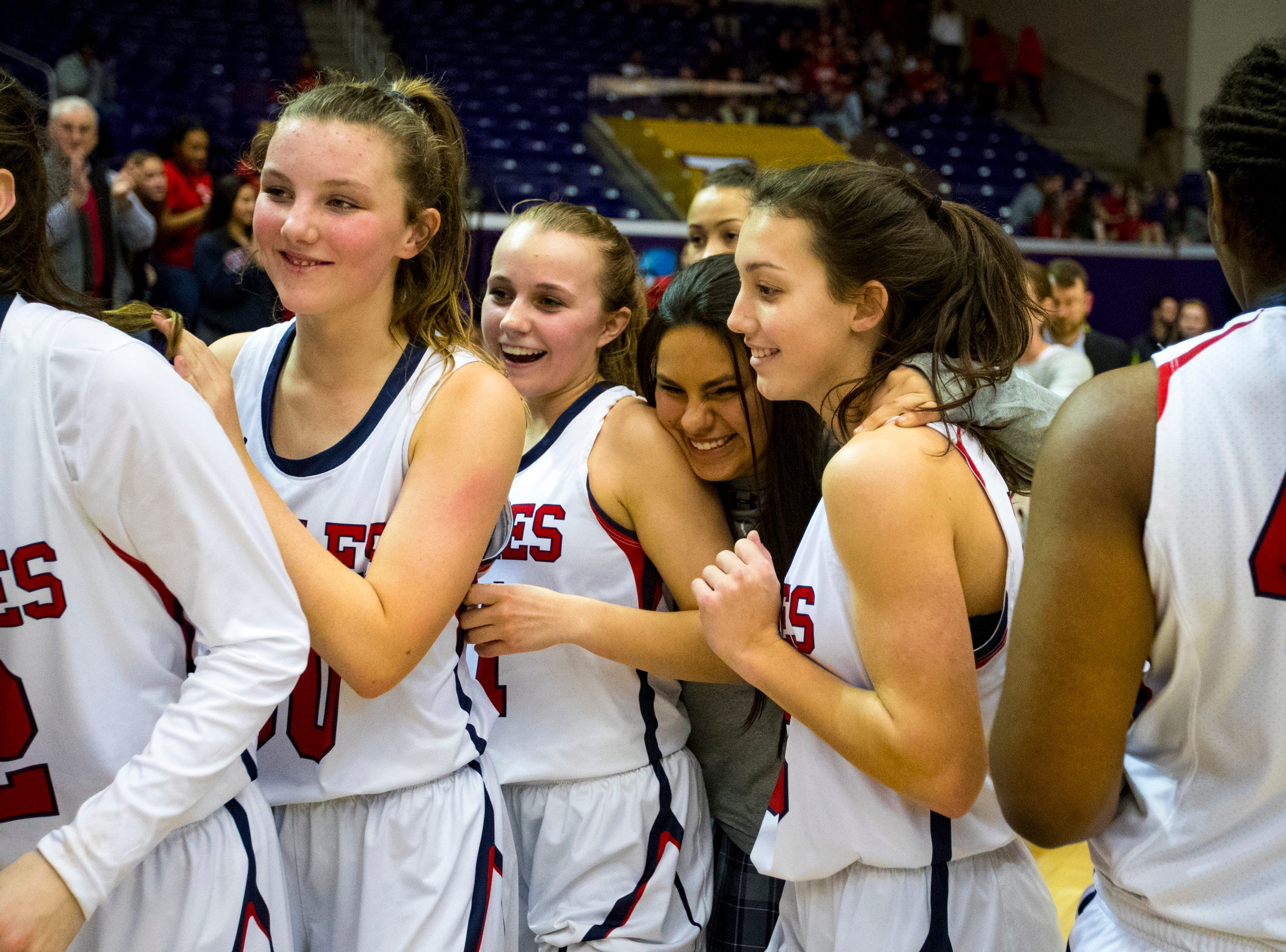 Brentwood Academy's players line up to shake hands after Brentwood Academy's game against Father Ryan in the semifinal round of the TSSAA Division II Class AA State Championships at Lipscomb University's Allen Arena in Nashville on Thursday, Feb. 28, 2019.