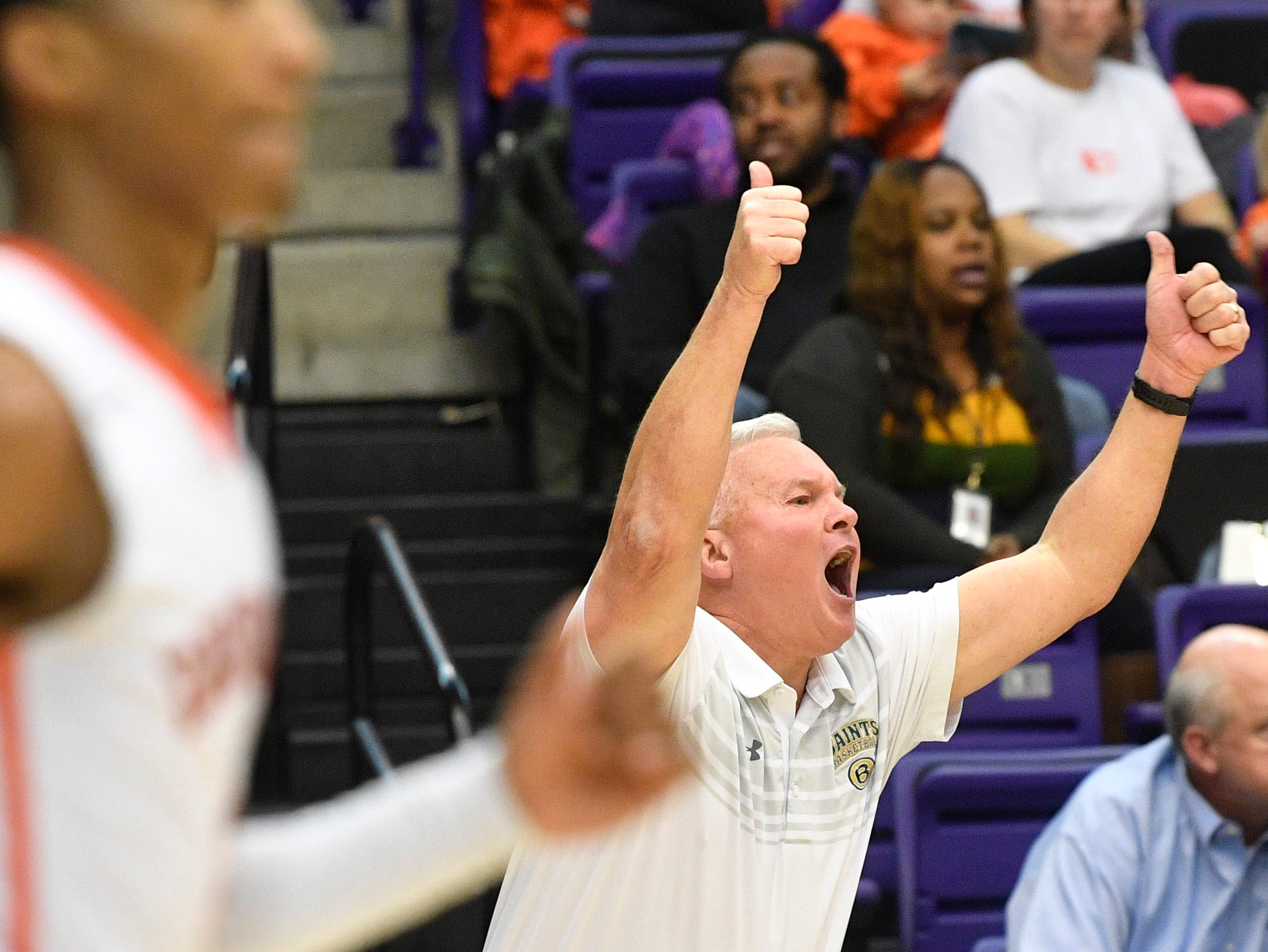 Coach John Harrington shouts encouragement to his team as Ensworth plays Briarcrest Christian in the Division II- AA semifinals at Allen Arena  Thursday, Feb. 28, 2019, in Nashville, Tenn.