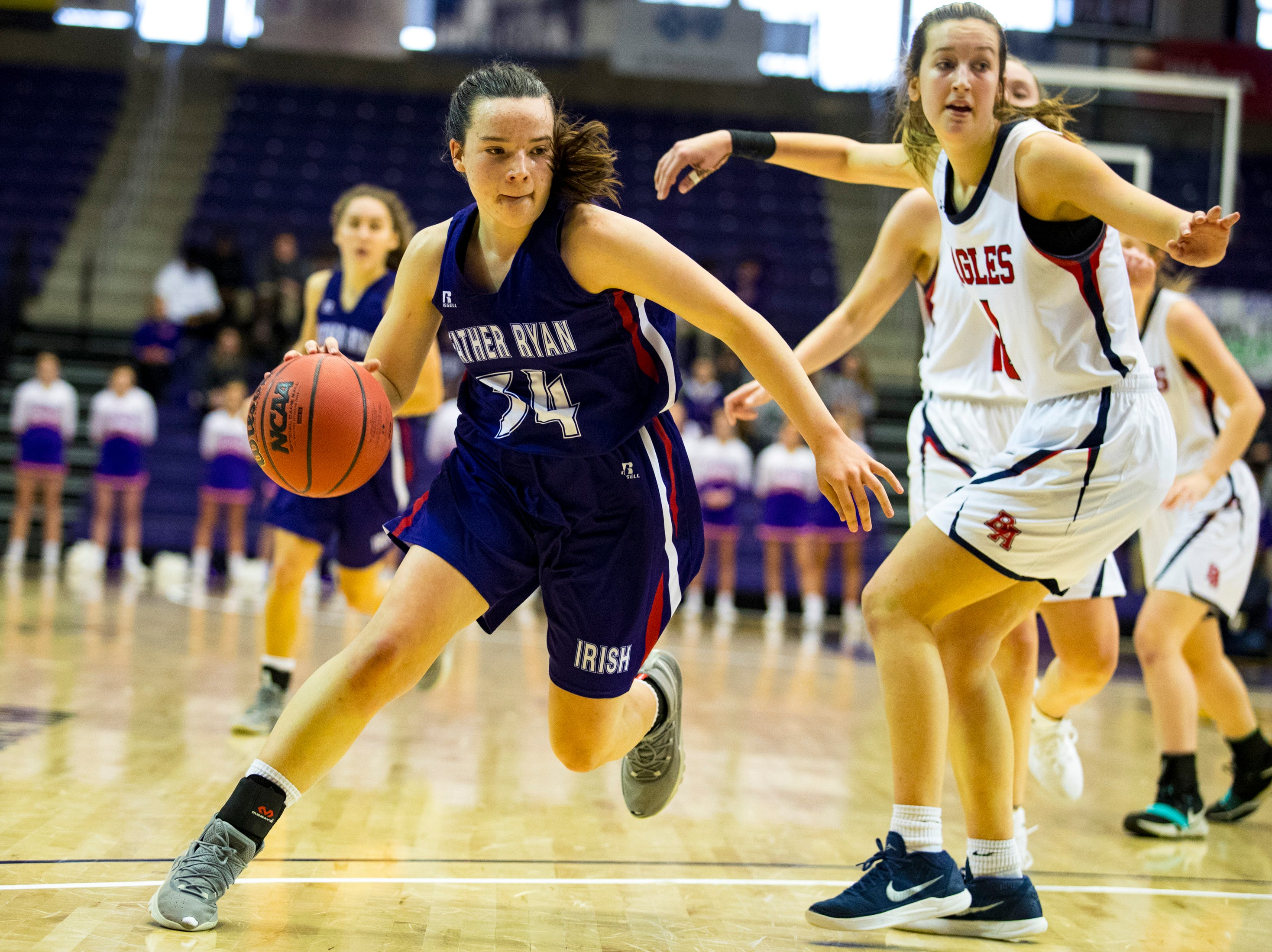 Father Ryan's Mary Mackie (34) moves the ball down court during Brentwood Academy's game against Father Ryan in the semifinal round of the TSSAA Division II Class AA State Championships at Lipscomb University's Allen Arena in Nashville on Thursday, Feb. 28, 2019.