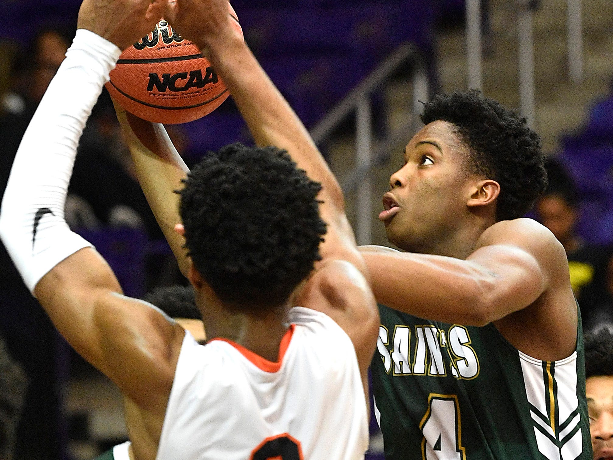 Lewis McDaniel and Marcellus Brigham go for a rebound as Ensworth plays Briarcrest Christian in the Division II- AA semifinals at Allen Arena  Thursday, Feb. 28, 2019, in Nashville, Tenn.
